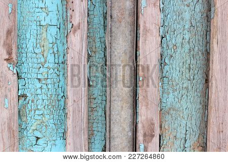 Background Texture Pattern Of Weathered Wooden Planks With Grungy Remnants Of Blue Paint Forming The