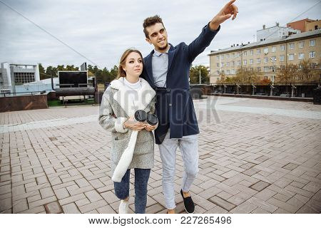 Young Couple In Love Walking In The City
