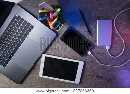 Laptop, Smart Phone And Tablet Pc On Dark Wooden Background. Top View