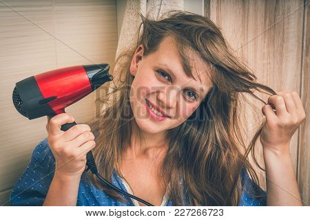 Fashion Girl With Red Hair Dryer Dries Her Hair - Retro Style