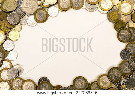 Coins, Money, View From The Top Lie On The Edge Of The Frame Forming A Circle In The Center