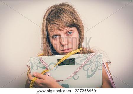 Overweight Woman Holding Digital Scales With Word Help! - Diet And Obesity Concept - Retro Style
