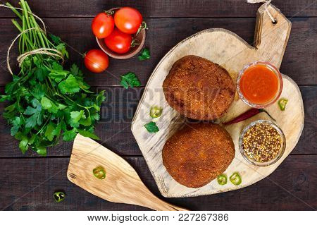 Large Juicy Cutlets Stuffed With Boiled Egg On A Cutting Board On A Dark Wooden Background. Scottish