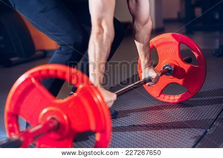 Weight Lifter Lifts The Weight. Close Up