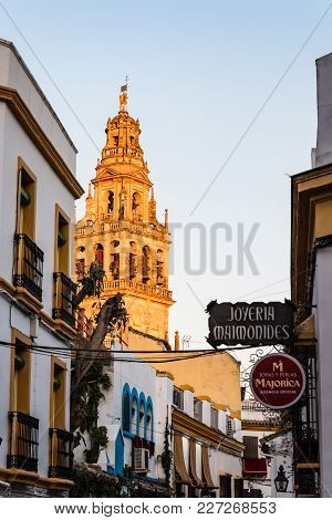 Cordoba, Spain - April 11, 2017: Old Typical Street In The Jewry Of Cordoba With Restaurants And The