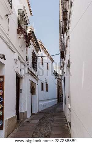 Cordoba, Spain - April 12, 2017: Old Typical Street In The Jewry Of Cordoba Near Synagogue With Whit