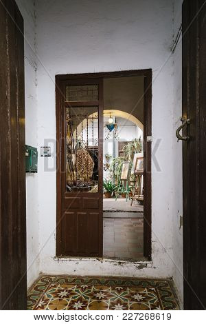 Cordoba, Spain - April 12, 2017: Entrance To Old Typical Courtyard Or Patio In The Jewish Quarter Of