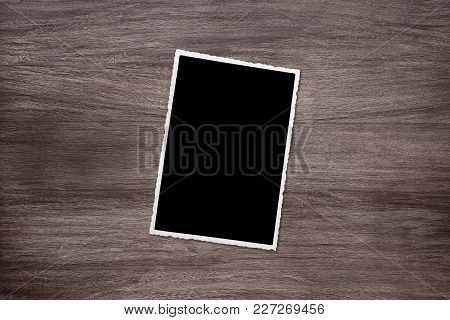 Blackened Old Vintage Photo Template On Rustic Wooden Background