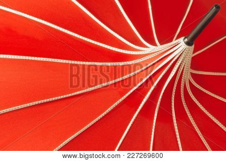 Top domed abstract section of a parasol umbrella