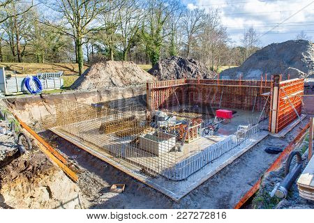 Underground Construction Site Of House With Concrete