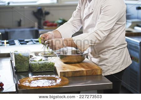 Chef Preparing A Salad In The Kitchen Of The Restaurant, Concept Of Cooking And Haute Cuisine