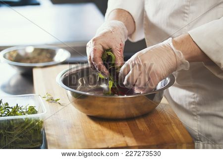 Chef Preparing A Salad In The Kitchen Of The Restaurant, Concept Of Cooking And Haute Cuisine - Clos