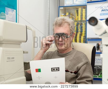 SAINT PETERSBURG, RUSSIA - FEBRUARY 13, 2018: A mature man with a model release checks eyesight in an ophthalmic clinic