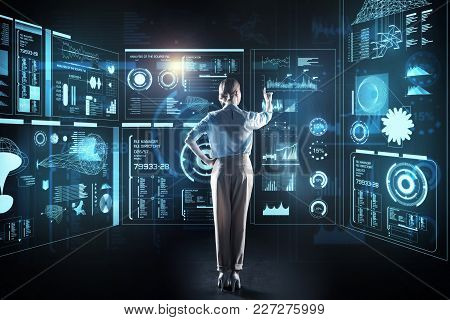 Elegant Programmer. Calm Clever Reliable Programmer Standing In Front Of A Giant Transparent Device