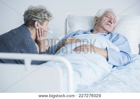 Woman Taking Care Of Husband