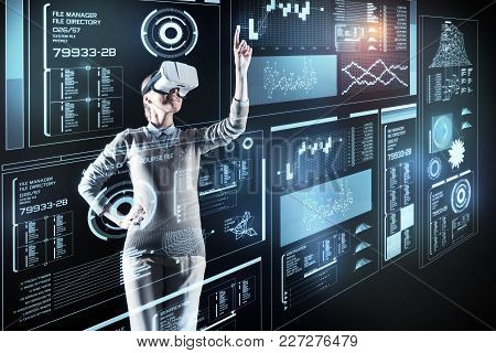 Beautiful Programmer. Cheerful Optimistic Young Programmer Standing In Front Of A Great Futuristic D