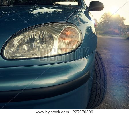 Car Headlight Close-up. Turn, Stop And Reverse Signals On Sunset