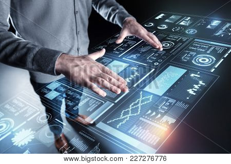 Controlling Programs. Smart Careful Experienced Programmer Standing With His Hands On The Transparen