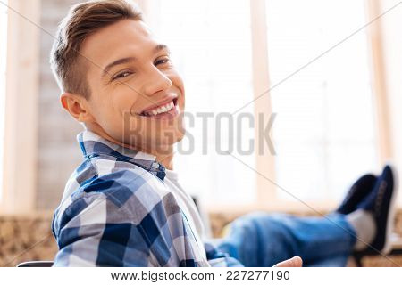 Enjoying My Weekend. Good-looking Cheerful Fair-haired Boy Smiling And Wearing A Tartan Shirt And Re