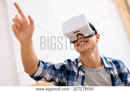 Entertainment. Joyful Well-built Stylish Adolescent Wearing A Vr Headset And Relaxing And Touching T