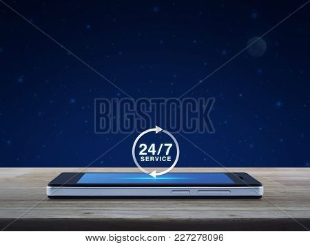 24 Hours Service Icon On Modern Smart Phone Screen On Wooden Table Over Fantasy Night Sky And Moon,