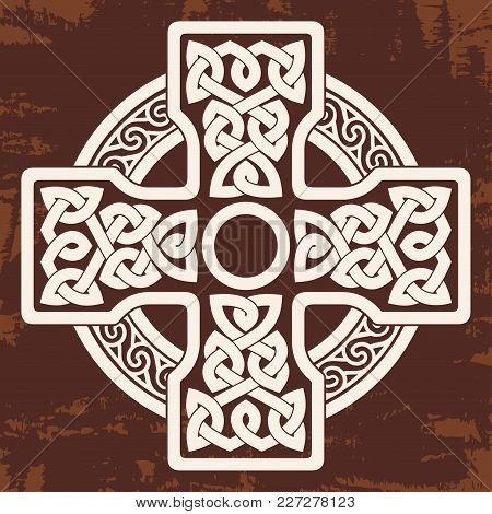 Celtic Cross With National Ornament As Interlaced Ribbon. Old Brown Background With The Aging Effect
