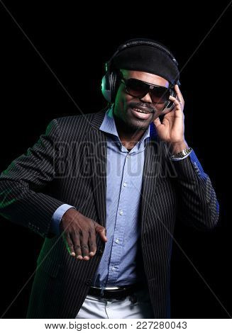 African American male DJ playing music at a party