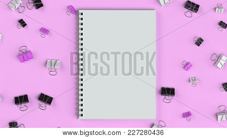Blank Spiral Notebook With Black, White And Purple Binder Clips On Purple Table