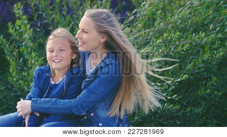 Happy mother and daughter in the park on vacation