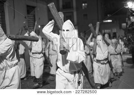 Procession That Takes Place On Easter Friday In Civitavecchia, In Italy. There Are Men And Women Hoo