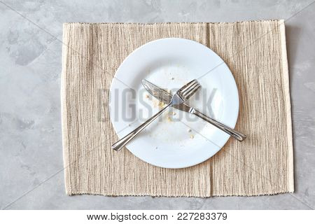 Metal fork and knife on a stone table. arrangement of cutlery after meals.