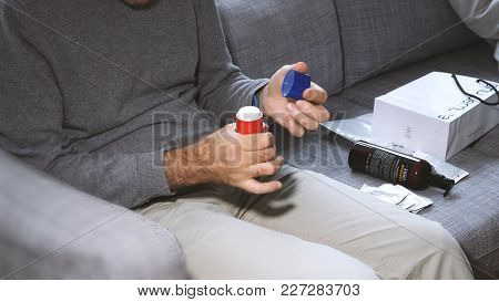 Man Unboxing On The Couch Cosmetics Containing