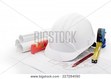 Architectural blueprints, safety helmet, building level, ruler and pencil on a white background. Architect workplace. Engineering tools