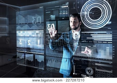 Numbers. Smart Experienced Qualified Programmer Looking Careful While Standing Alone In A Dark Offic