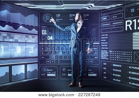 Personal Information. Calm Clever Experienced Programmer Standing Next To The Big Futuristic Screen