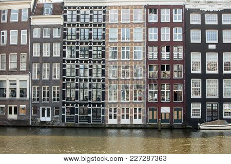 Typical Gabled Houses On Damrak Street In Amsterdam, Holland, Netherlands
