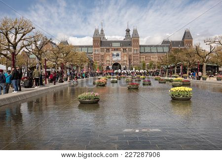 Amsterdam, Netherlands - April 22 2017: Rijksmuseum National Museum With I Amsterdam Sign And Tulips