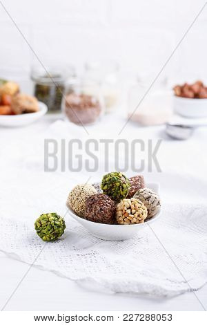 Healthy Energy Balls Made Of Dried Fruits And Nuts With Coconut Chips, Flax Seeds, Pistachios, Sesam