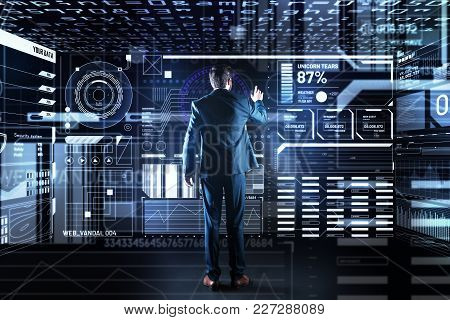 Calm Employee. Clever Qualified Experienced Programmer Standing In Front Of A Large Transparent Scre