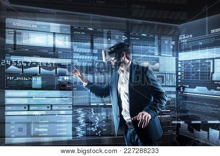 Futuristic Technologies. Clever Progressive Young Programmer Wearing Convenient Virtual Reality Glas