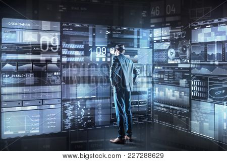 Making Decision. Calm Concentrated Young Programmer With Virtual Reality Glasses Standing In Front O