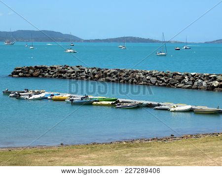 Airlie Beach, Queenland, Australia-dec 19, 2017:  Various Types Of Tender Boats Tied To A Floating P