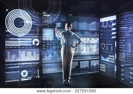 Feeling Satisfied. Calm Clever Reliable Database Administrator Standing In Front Of A Giant Futurist