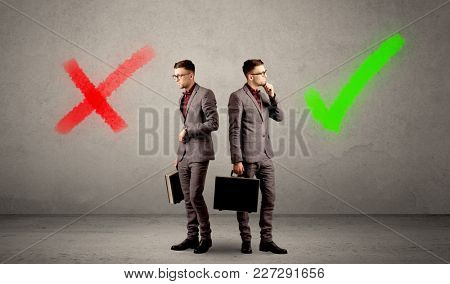 Young conflicted businessman choosing between a right and a wrong direction