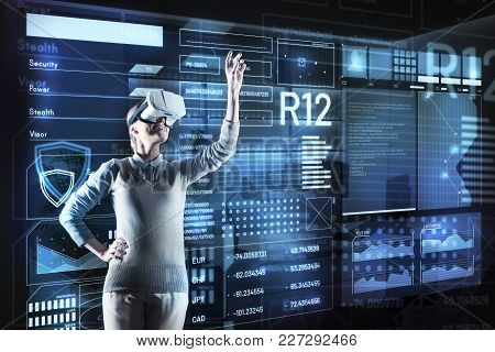 Smiling Programmer. Cheerful Enthusiastic Clever Programmer Wearing Virtual Reality Glasses And Stan