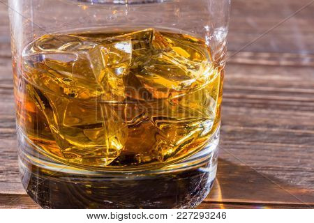 whiskey with ice cube