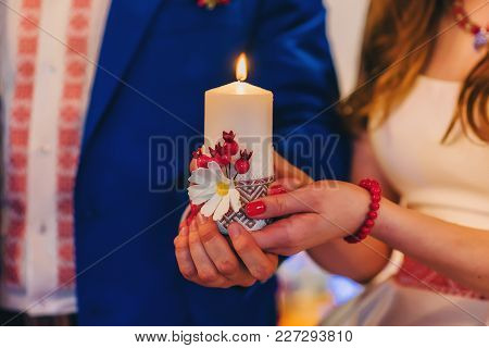 Bride And Groom Holding A Candle. Wedding Religious Christian Tradition