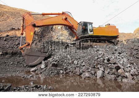 Manganese Mining And Processing Using A Excavator Machine