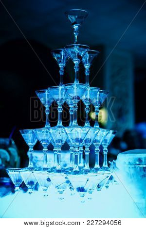 Group Of Martini Glasses With Bright Blue Illumination At The Event