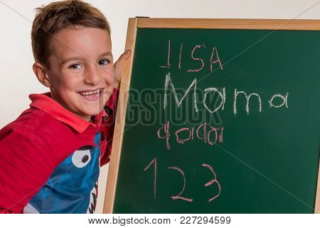 schoolchild with school blackboard
